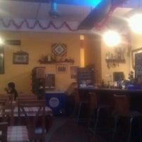 Photo taken at La Cocina Restaurant & Tapas Bar by K V S. on 2/1/2012