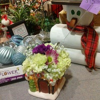 Photo taken at The Family Flower Shoppe by Sara S. on 12/17/2011