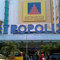 Photo taken at Metropolis Town Square by Adhari H. on 7/20/2012