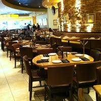 Photo taken at California Pizza Kitchen by Derek W. on 5/27/2012