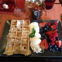 Photo taken at Belga Cafe by Jake V. on 7/21/2012