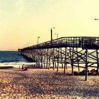 Photo taken at Oak Island Pier by Brian C. on 7/12/2011