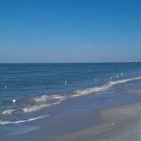 Photo taken at Bonita Beach by Sirius B. on 1/30/2012