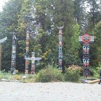 Photo taken at Totem Poles in Stanley Park by Tomomi N. on 10/5/2011