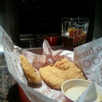 Photo taken at Red Robin Gourmet Burgers by Sotonye S. on 9/27/2011