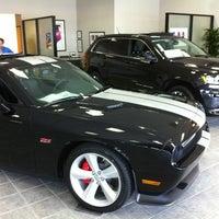 Photo taken at Swift Chrysler Jeep Dodge Ram & Kia by Bryan B. on 4/11/2012