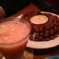 Photo taken at Outback Steakhouse by Carly G. on 7/13/2011