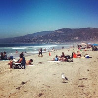 Photo taken at Zuma Beach by Lucas M. on 7/19/2012
