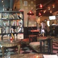 Photo taken at Estragon Tapas Bar by Landis S. on 5/25/2012