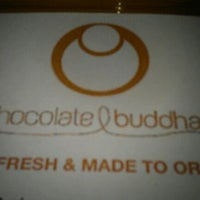 Photo taken at Chocolate Buddha by Emily F. on 5/18/2012
