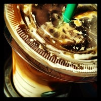 Photo taken at Starbucks by UNEARTHED on 7/25/2012
