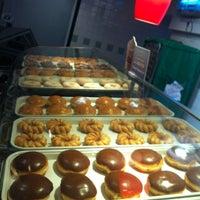 Photo taken at Krispy Kreme by Esteban T. on 3/30/2012