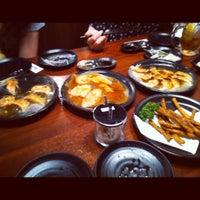 Photo taken at 博多餃子舎603 by と び. on 7/7/2012