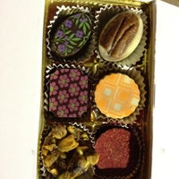 Photo taken at Lilly Handmade Chocolates by Ezgi T. on 7/21/2012