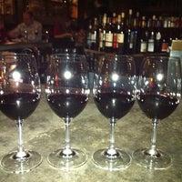 Photo taken at Purple Café & Wine Bar by Jenny K. on 12/4/2011
