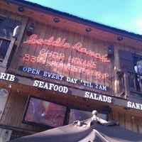 Photo taken at Saddle Ranch Chop House by Kyle D. on 11/13/2011