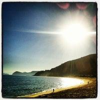 Photo taken at Praia de Boiçucanga by Laércio G. on 8/12/2012