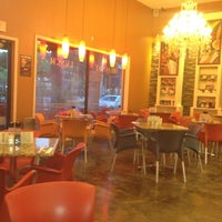 Photo taken at Saquella Cafe by Mike E. on 8/30/2012