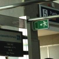 Photo taken at Gate 5 Aeropuerto Internacional Juan Santamaria by Alejandro on 9/4/2012