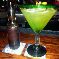 Photo taken at Bailey's Sports Grille by Yvonne H. on 7/11/2012