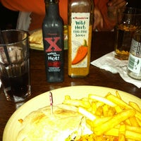 Photo taken at Nando's by Sunay S. on 1/7/2012