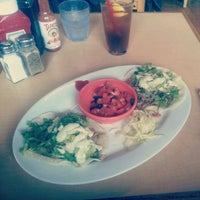 Photo taken at Beach Grass Cafe by Mike D. on 4/13/2012