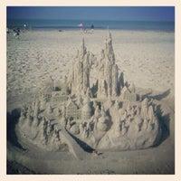 Photo taken at Coronado Beach by Fiona C. on 8/26/2012