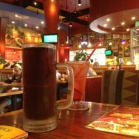 Photo taken at Red Robin Gourmet Burgers by Sam J. on 8/16/2012