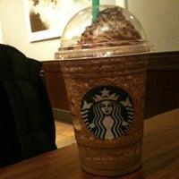 Photo taken at Starbucks by Tiago S. on 5/27/2012
