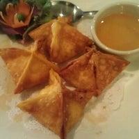 Photo taken at Thai Basil Restaurant by Erin S. on 5/24/2012