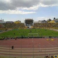 Photo taken at Estadio Olimpico Atahualpa by Sebastian V. on 9/7/2012
