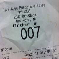 Photo taken at Five Guys by Emilie R. on 12/28/2011