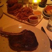Photo taken at Fleming's Prime Steakhouse & Wine Bar by Tanuki Data M. on 12/28/2011