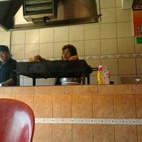 Photo taken at Tacos Los Poblanitos by Florencio C. on 2/17/2012
