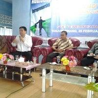 Photo taken at STIE Pembangunan by Anggie N. on 2/25/2012