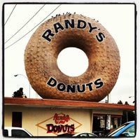 Photo taken at Randy's Donuts by Jonathan B. on 6/16/2012