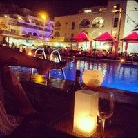 Photo taken at La Jacaranda Lounge Ibiza by Uri B. on 8/18/2012