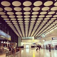 Photo taken at Terminal 4 by Lorena R. on 9/2/2012