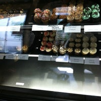 Photo taken at Indulgence Cupcakery by danniB on 6/29/2012