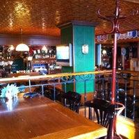 Photo taken at Mollie's Irish Pub by Vova S. on 5/7/2012