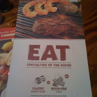 Photo taken at Outback Steakhouse by Bryce G. on 12/28/2011