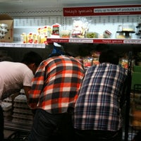 Photo taken at Fresh & Easy Neighborhood Market by trisha v. on 5/25/2011