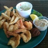 Photo taken at Iguanas Seafood Restaurant by Morris W. on 10/25/2011