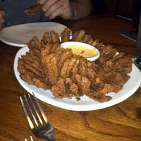 Photo taken at Outback Steakhouse by Andrea M. on 12/26/2011
