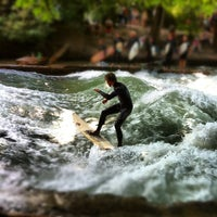 Photo taken at Eisbach Wave by Lukas G. on 7/18/2012