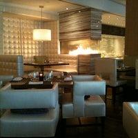 Photo taken at Härth Restaurant by Ryan R. on 5/8/2012