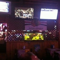 Photo taken at Mother Hubbard's Sports Pub by Herve A. on 3/4/2011