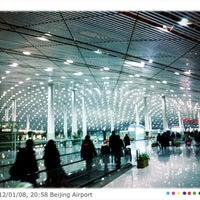 Photo taken at Beijing Capital International Airport (PEK) by Tagosaku J. on 1/8/2012