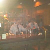 Photo taken at Boca Steak & Seafood by Matt E. on 12/18/2011