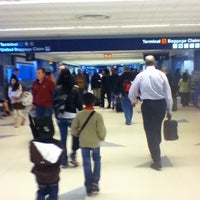 Photo taken at Terminal 2 by Briana R. on 4/16/2012
